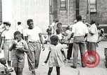 Image of African American children in Harlem New York City USA, 1935, second 5 stock footage video 65675063279