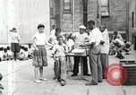 Image of African American children in Harlem New York City USA, 1935, second 16 stock footage video 65675063279