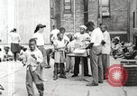 Image of African American children in Harlem New York City USA, 1935, second 18 stock footage video 65675063279