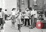 Image of African American children in Harlem New York City USA, 1935, second 22 stock footage video 65675063279