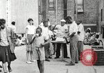 Image of African American children in Harlem New York City USA, 1935, second 23 stock footage video 65675063279