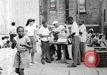 Image of African American children in Harlem New York City USA, 1935, second 25 stock footage video 65675063279