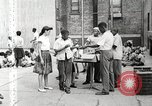 Image of African American children in Harlem New York City USA, 1935, second 27 stock footage video 65675063279