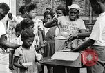 Image of African American children in Harlem New York City USA, 1935, second 42 stock footage video 65675063279