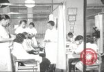 Image of Beauty parlor for African American women in Harlem New York City USA, 1940, second 16 stock footage video 65675063284