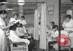 Image of Beauty parlor for African American women in Harlem New York City USA, 1940, second 20 stock footage video 65675063284