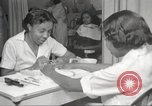 Image of Beauty parlor for African American women in Harlem New York City USA, 1940, second 23 stock footage video 65675063284