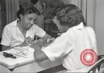 Image of Beauty parlor for African American women in Harlem New York City USA, 1940, second 26 stock footage video 65675063284
