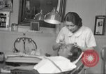 Image of Beauty parlor for African American women in Harlem New York City USA, 1940, second 30 stock footage video 65675063284