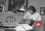 Image of Beauty parlor for African American women in Harlem New York City USA, 1940, second 32 stock footage video 65675063284