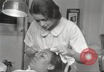 Image of Beauty parlor for African American women in Harlem New York City USA, 1940, second 34 stock footage video 65675063284