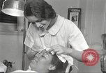 Image of Beauty parlor for African American women in Harlem New York City USA, 1940, second 36 stock footage video 65675063284