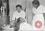 Image of Beauty parlor for African American women in Harlem New York City USA, 1940, second 47 stock footage video 65675063284
