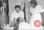 Image of Beauty parlor for African American women in Harlem New York City USA, 1940, second 48 stock footage video 65675063284