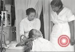 Image of Beauty parlor for African American women in Harlem New York City USA, 1940, second 49 stock footage video 65675063284