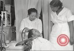 Image of Beauty parlor for African American women in Harlem New York City USA, 1940, second 50 stock footage video 65675063284