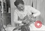 Image of Beauty parlor for African American women in Harlem New York City USA, 1940, second 52 stock footage video 65675063284