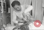 Image of Beauty parlor for African American women in Harlem New York City USA, 1940, second 53 stock footage video 65675063284