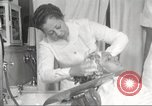 Image of Beauty parlor for African American women in Harlem New York City USA, 1940, second 54 stock footage video 65675063284