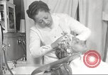 Image of Beauty parlor for African American women in Harlem New York City USA, 1940, second 55 stock footage video 65675063284