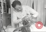 Image of Beauty parlor for African American women in Harlem New York City USA, 1940, second 56 stock footage video 65675063284