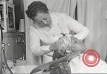Image of Beauty parlor for African American women in Harlem New York City USA, 1940, second 57 stock footage video 65675063284