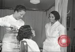 Image of Beauty parlor for African American women in Harlem New York City USA, 1940, second 59 stock footage video 65675063284