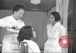 Image of Beauty parlor for African American women in Harlem New York City USA, 1940, second 61 stock footage video 65675063284