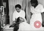 Image of Young Women's Christian Association beauty parlor Harlem New York City USA, 1940, second 46 stock footage video 65675063300
