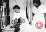 Image of Young Women's Christian Association beauty parlor Harlem New York City USA, 1940, second 48 stock footage video 65675063300