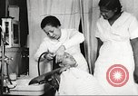 Image of Young Women's Christian Association beauty parlor Harlem New York City USA, 1940, second 49 stock footage video 65675063300