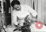 Image of Young Women's Christian Association beauty parlor Harlem New York City USA, 1940, second 52 stock footage video 65675063300