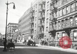 Image of YMCA building with view of streets Harlem New York City USA, 1940, second 51 stock footage video 65675063319