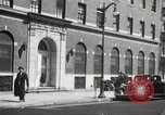 Image of YMCA building with view of streets Harlem New York City USA, 1940, second 58 stock footage video 65675063319