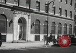 Image of YMCA building with view of streets Harlem New York City USA, 1940, second 59 stock footage video 65675063319