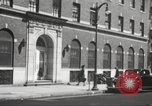 Image of YMCA building with view of streets Harlem New York City USA, 1940, second 61 stock footage video 65675063319