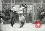 Image of Couple performing dances for camera Europe, 1913, second 60 stock footage video 65675063369