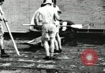 Image of Harvard 8 man crew participating in regatta on Thames River at New Lon New London Connecticut USA, 1900, second 18 stock footage video 65675063383