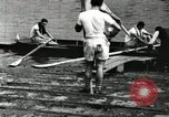 Image of Harvard 8 man crew participating in regatta on Thames River at New Lon New London Connecticut USA, 1900, second 27 stock footage video 65675063383