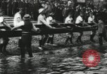 Image of Scenes from an annual Harvard and Yale rowing race on the Thames River New London Connecticut USA, 1900, second 13 stock footage video 65675063384