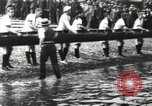 Image of Scenes from an annual Harvard and Yale rowing race on the Thames River New London Connecticut USA, 1900, second 14 stock footage video 65675063384