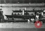 Image of Scenes from an annual Harvard and Yale rowing race on the Thames River New London Connecticut USA, 1900, second 18 stock footage video 65675063384