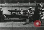 Image of Scenes from an annual Harvard and Yale rowing race on the Thames River New London Connecticut USA, 1900, second 19 stock footage video 65675063384