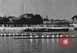 Image of Scenes from an annual Harvard and Yale rowing race on the Thames River New London Connecticut USA, 1900, second 31 stock footage video 65675063384