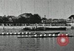 Image of Scenes from an annual Harvard and Yale rowing race on the Thames River New London Connecticut USA, 1900, second 33 stock footage video 65675063384