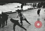 Image of Ice skating races outdoors on a flooded stadium ice rink during winter United States USA, 1900, second 2 stock footage video 65675063386