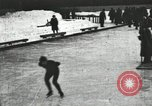 Image of Ice skating races outdoors on a flooded stadium ice rink during winter United States USA, 1900, second 3 stock footage video 65675063386