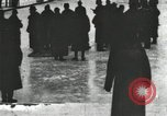 Image of Ice skating races outdoors on a flooded stadium ice rink during winter United States USA, 1900, second 4 stock footage video 65675063386