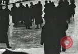 Image of Ice skating races outdoors on a flooded stadium ice rink during winter United States USA, 1900, second 5 stock footage video 65675063386