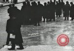 Image of Ice skating races outdoors on a flooded stadium ice rink during winter United States USA, 1900, second 13 stock footage video 65675063386